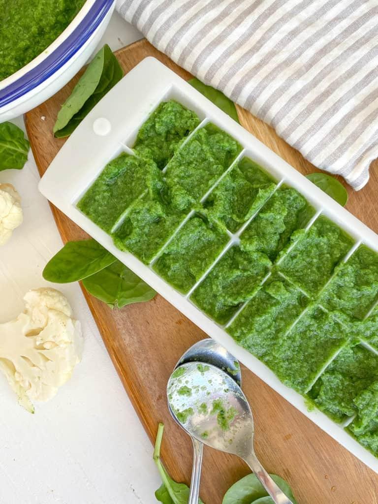 green puree transferred to ice cube trays