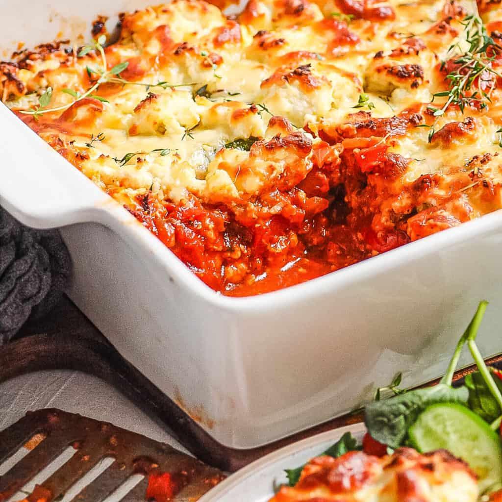 finished vegetarian zucchini lasagna in a white baking dish