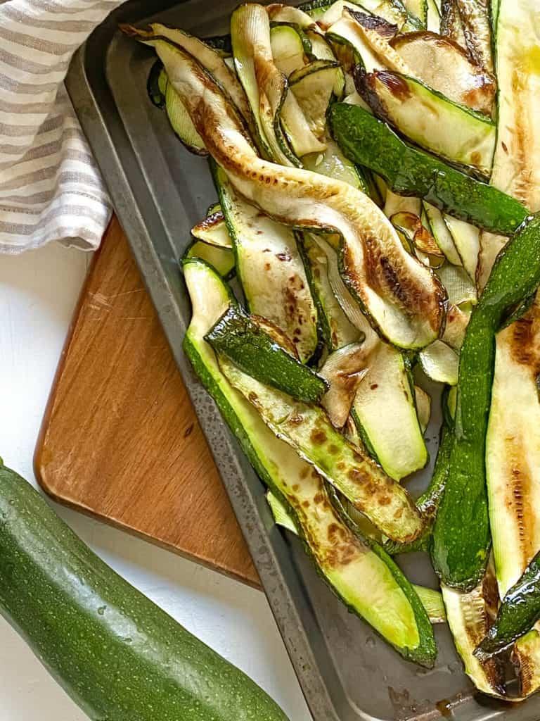 zucchini roasted on a baking sheet
