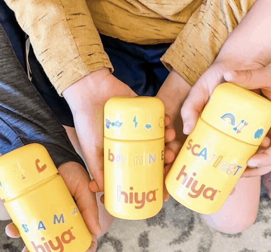 hiya vitamins bottles being held by kids