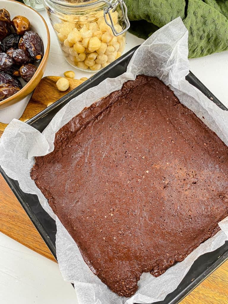 dough for lara bars in a baking dish