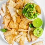Tortilla chips in bowl with guacamole.