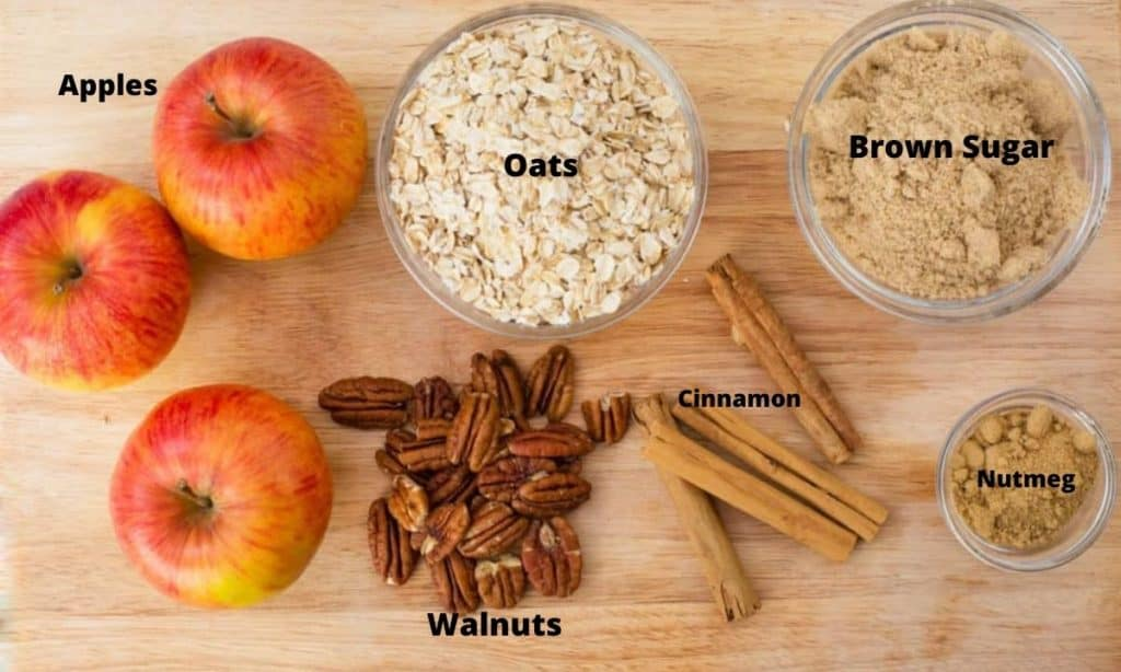 Ingredients for gluten-free apple crisp: apples, oats, brown sugar, cinnamon, nutmeg, walnuts.