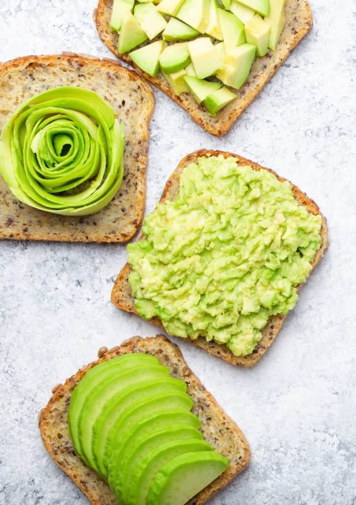 Four different kinds of avocado toast.