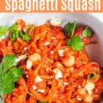 Curry spaghetti squash topped with fresh herbs.