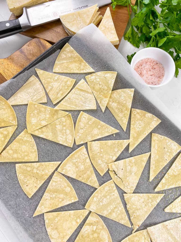 cut tortilla triangles on parchment paper