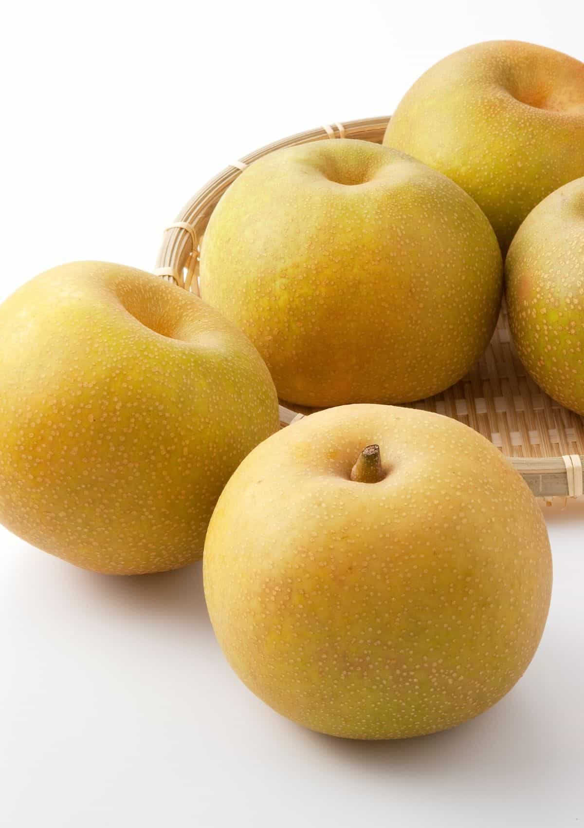 Nashi pears in basket.