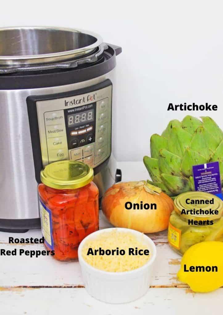 Instant pot risotto ingredients: arborio rice, roasted red peppers in jar, artichoke hearts in jar, lemon, onion, fresh artichoke.