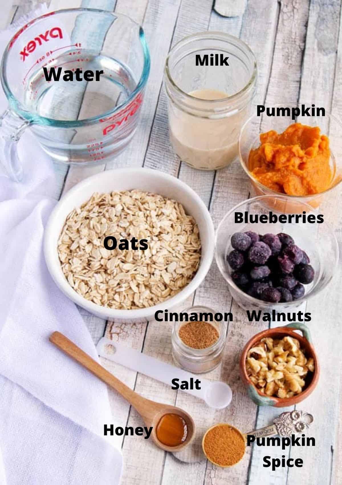 Pumpkin spice oatmeal ingredients: water, oats, milk, blueberries, pumpkin, walnuts, cinnamon, salt, honey, pumpkin spice.