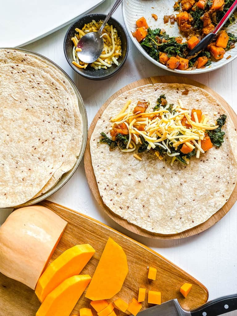 tortillas topped with veggie filling and cheese