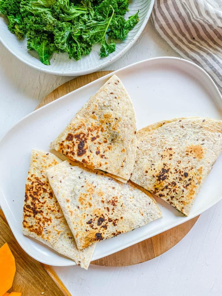 vegan quesadillas cut into triangles on a plate