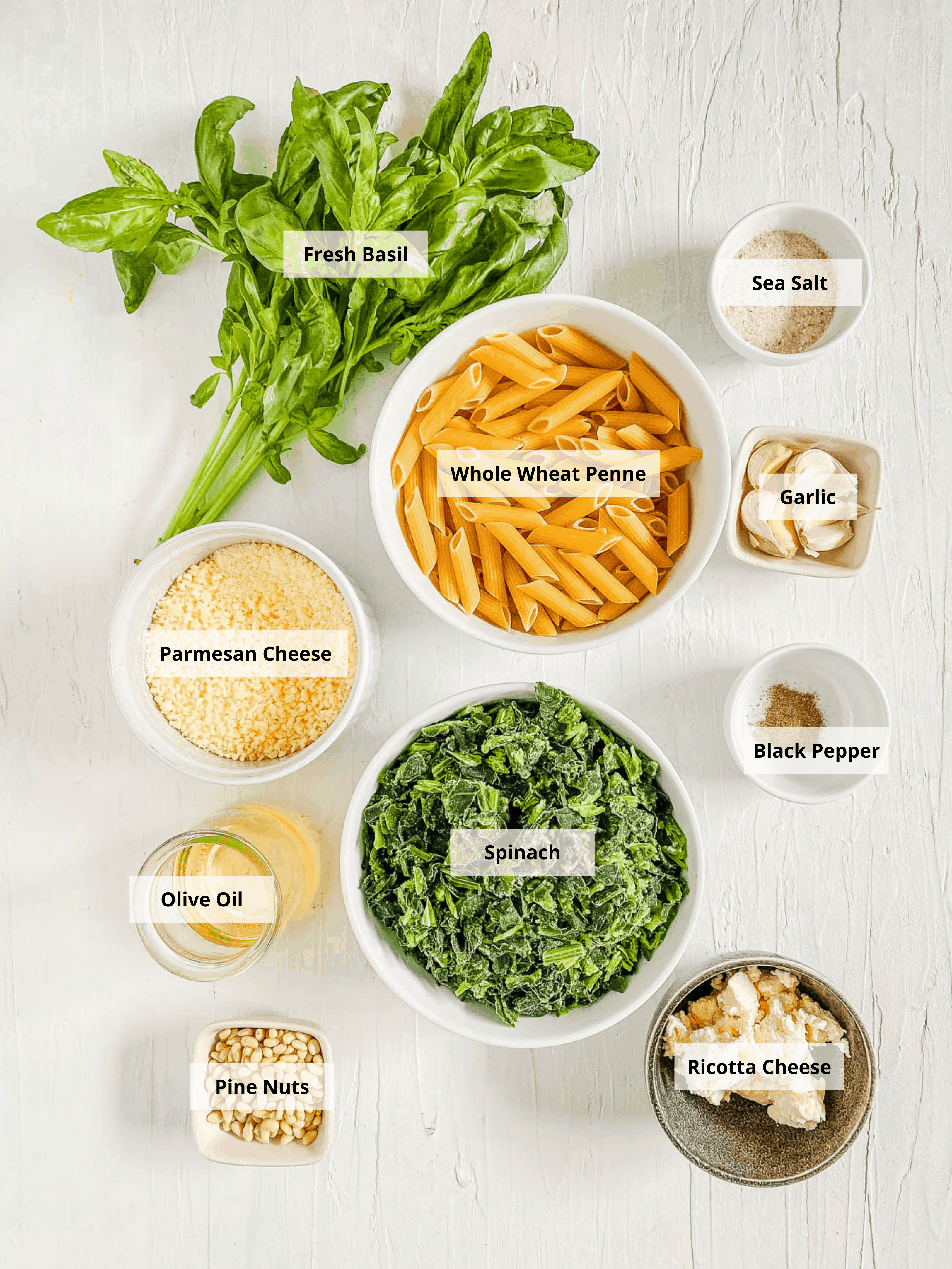ingredients for vegetarian pesto pasta recipe with spinach, basil and pine nuts