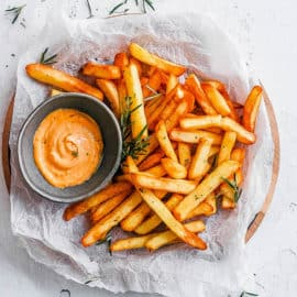 air fryer frozen french fries on a plate with ketchup