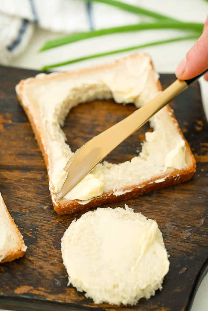 toast buttered with a hole cut out of the center