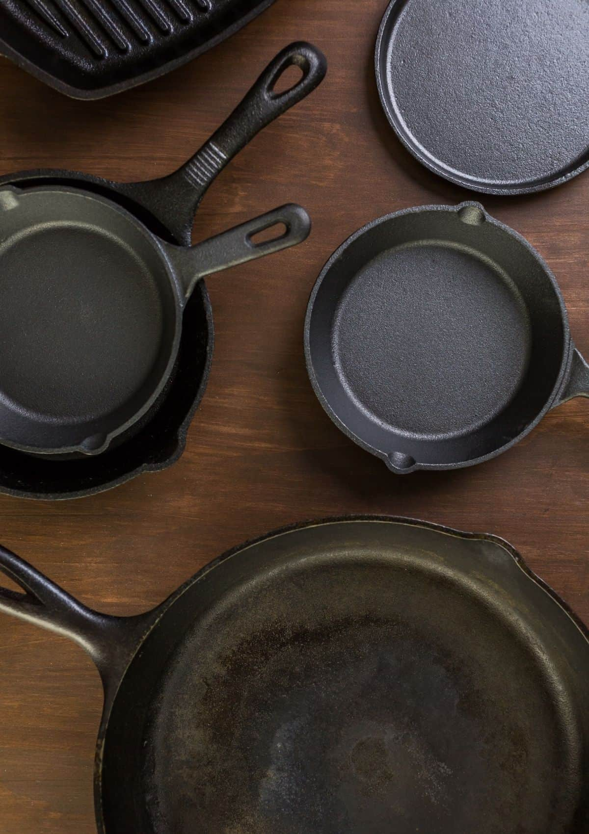 Cast iron pans on wood countertop.