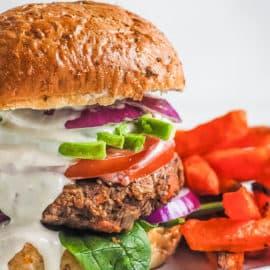 chipotle black bean burgers with tahini sauce and sweet potato fries