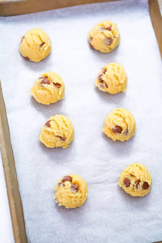 cookie dough balls on a baking shete