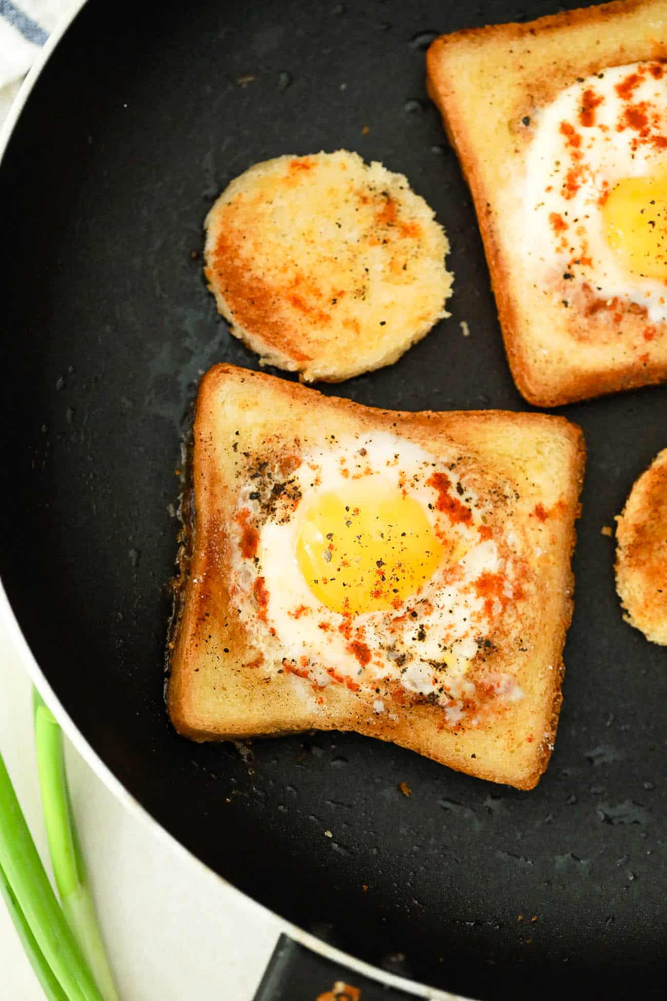 eggs in a basket still cooking in a skillet