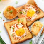 eggs in a basket - a classic vegetarian breakfast served on a white plate