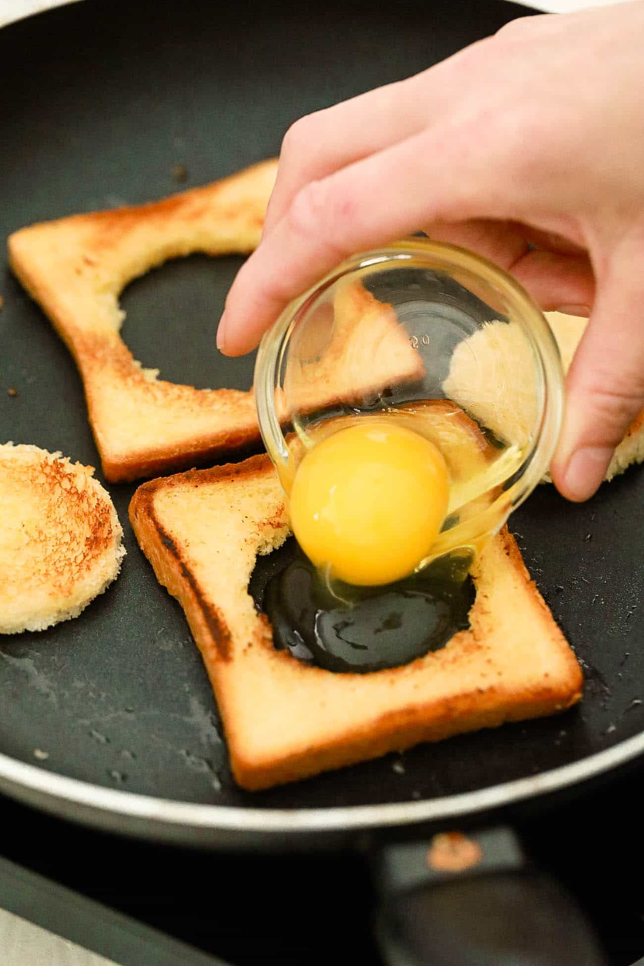 eggs added to toast in a skillet