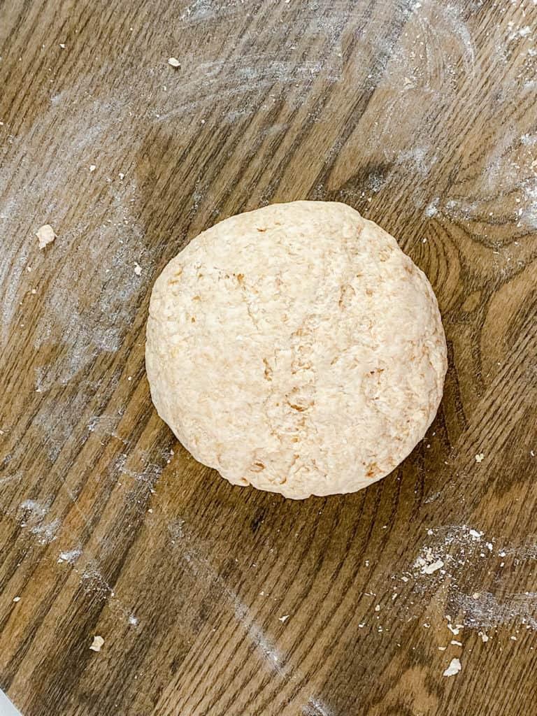 pizza dough ball on cutting board