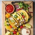 Vegetarian tacos on wood cutting board.