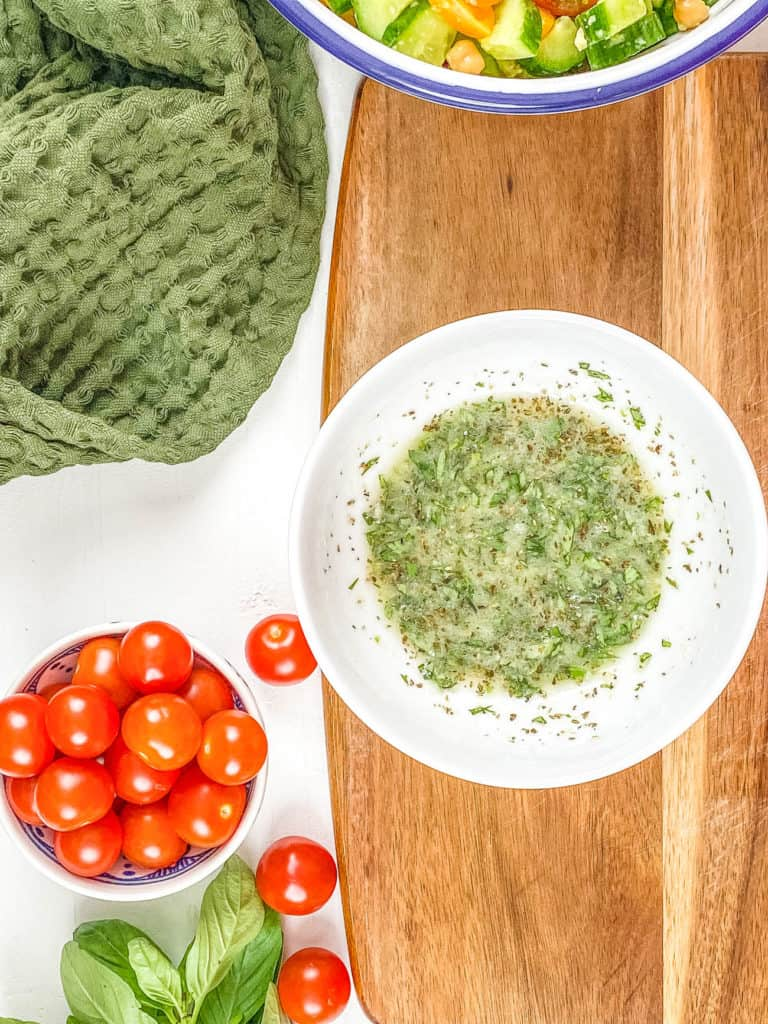 salad dressing in a white bowl