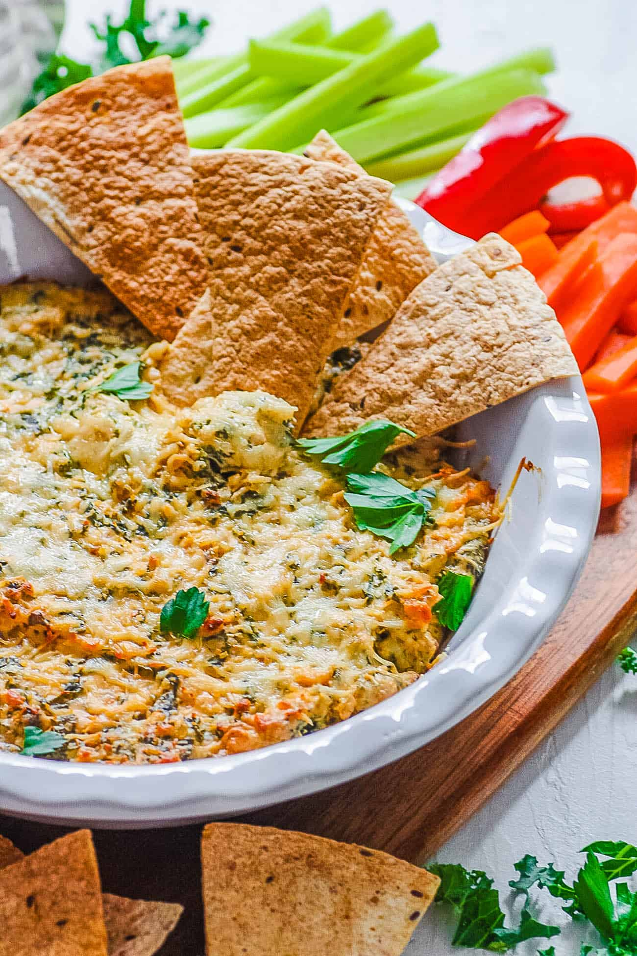 healthy cheese dip - easy kale dip recipe with pita chips in a white bowl