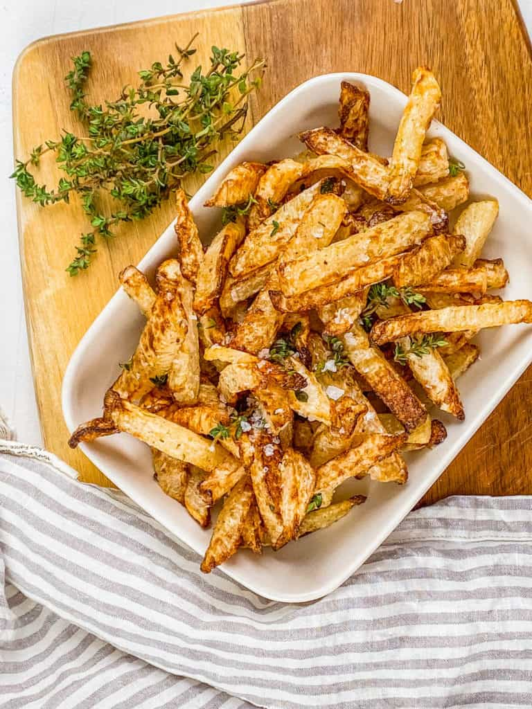 recipe for air fryer jicama fries in a white serving dish