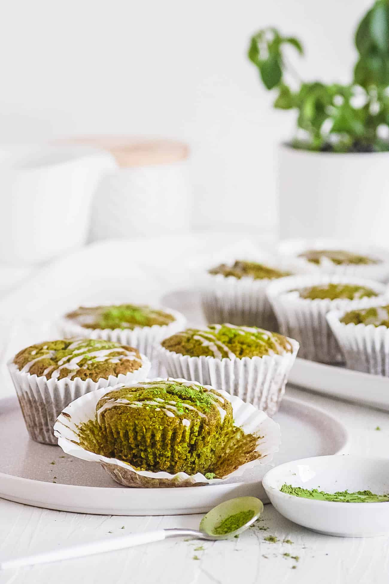 easy healthy matcha muffins recipe on a white plate with lemon frosting