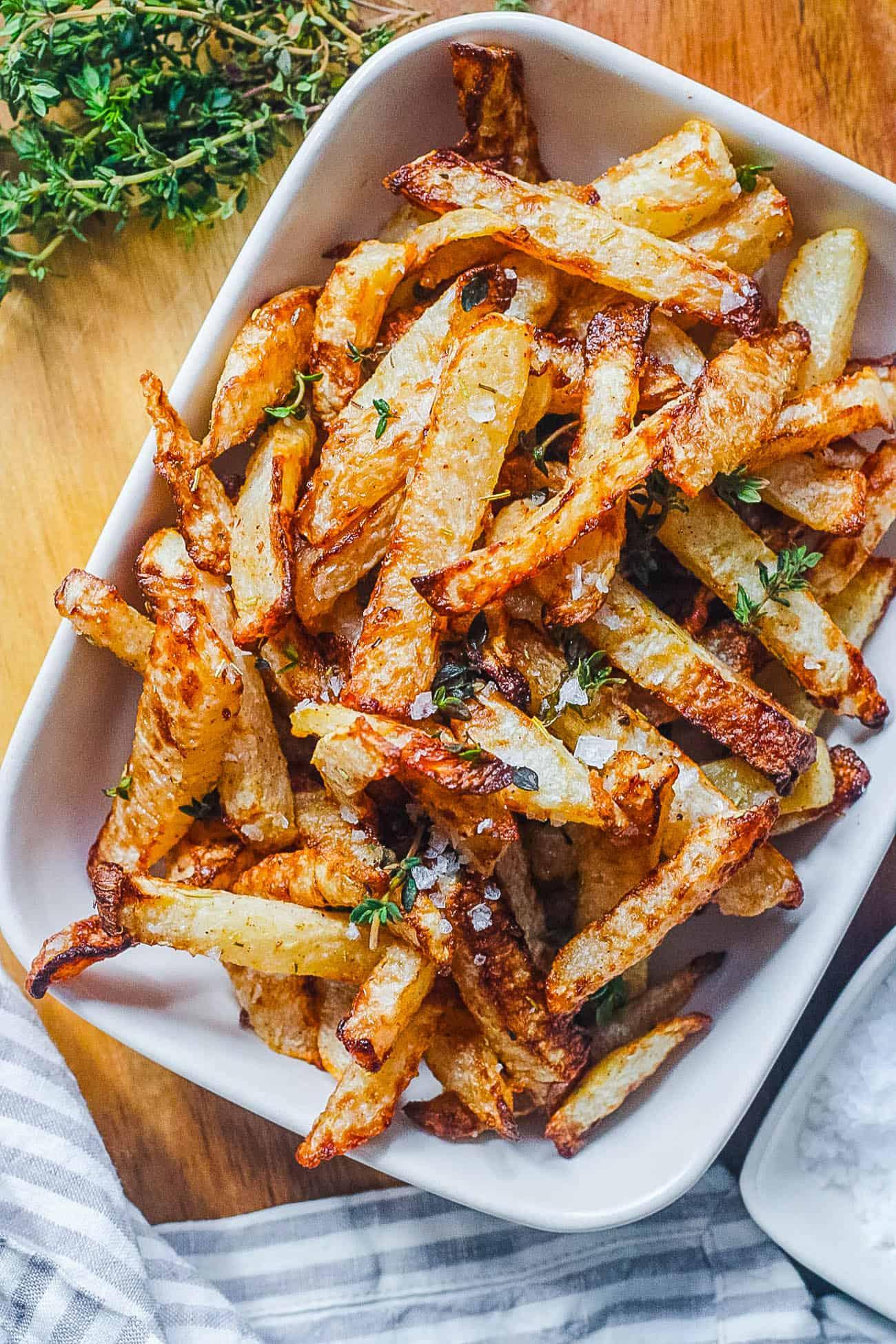 vegan easy air fryer jicama fries in a white serving dish