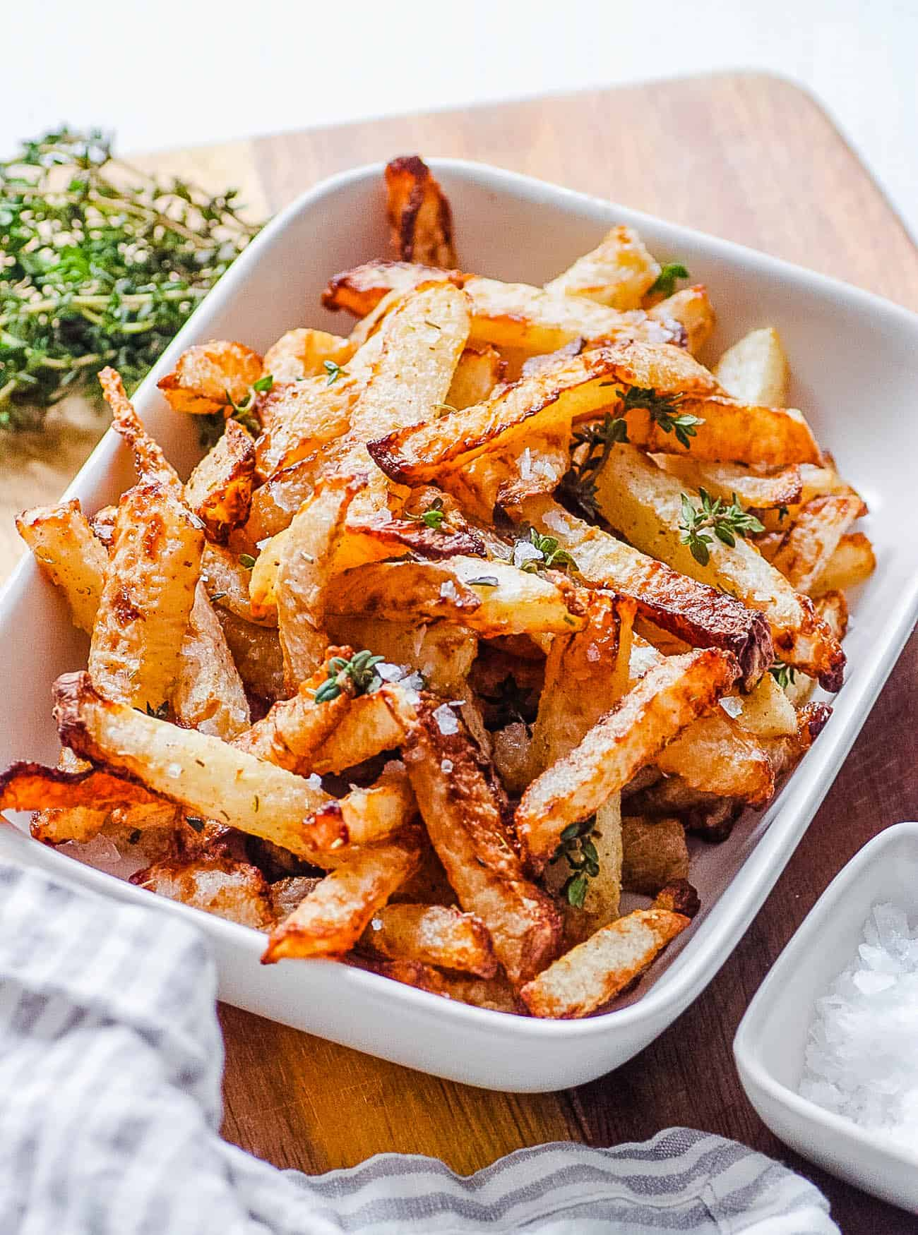 healthy easy air fryer jicama fries in a white serving dish