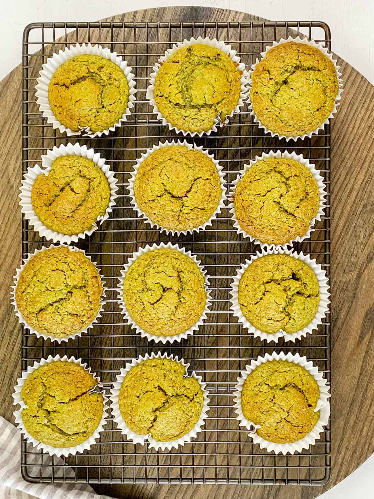 easy matcha muffins fresh out of the oven on a wire rack