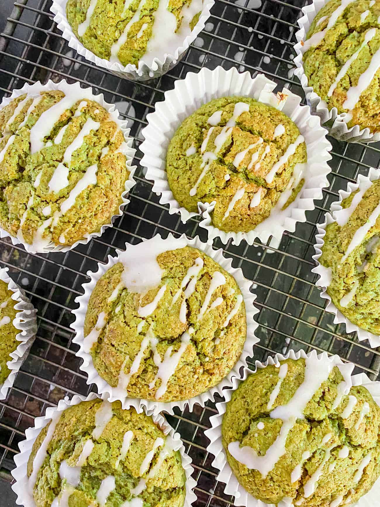 easy healthy matcha muffins recipe on a wire rack with lemon frosting