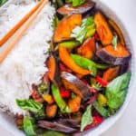 vegan thai basil eggplant recipe served with rice in a white bowl