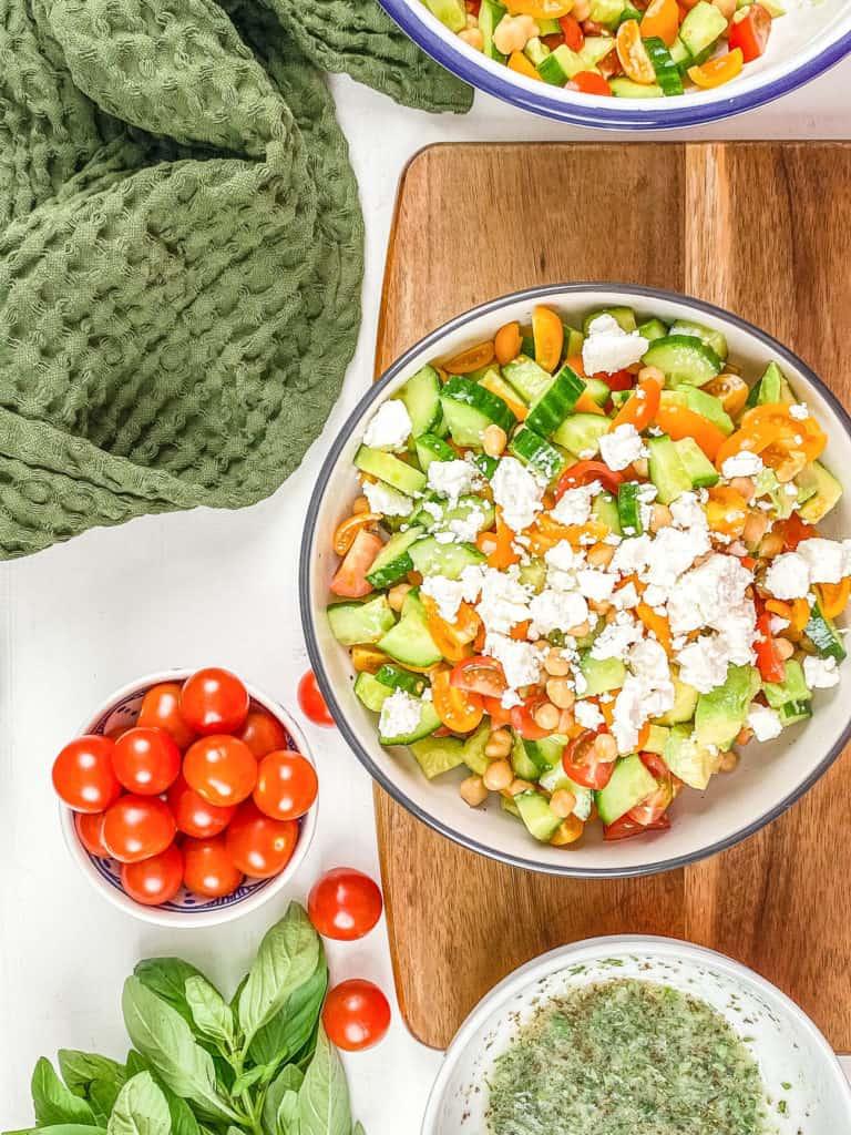 feta added to tomato avocado cucumber salad
