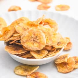 healthy easy air fryer banana chips in a white bowl