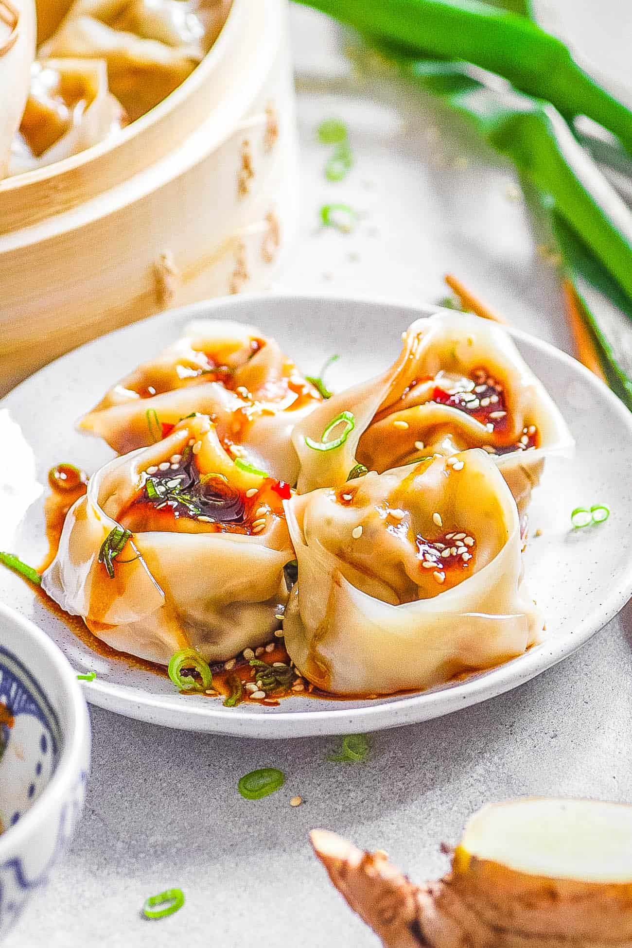 easy vegetarian wontons served on a white plate with dipping sauce
