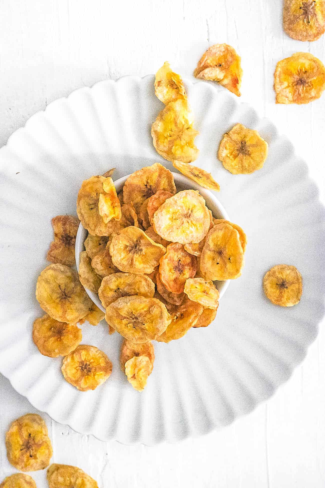 healthy easy air fryer banana chips recipe in a white bowl