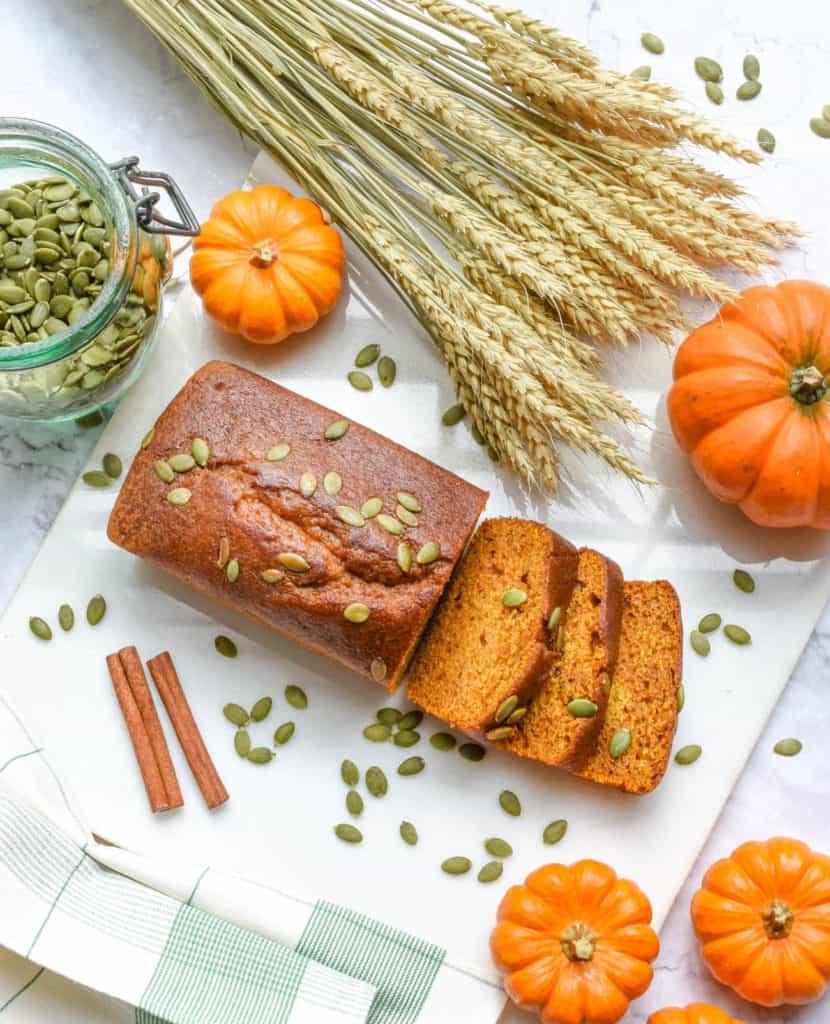 healthy easy vegan pumpkin bread gluten free - on a white background with pumpkin seeds on top