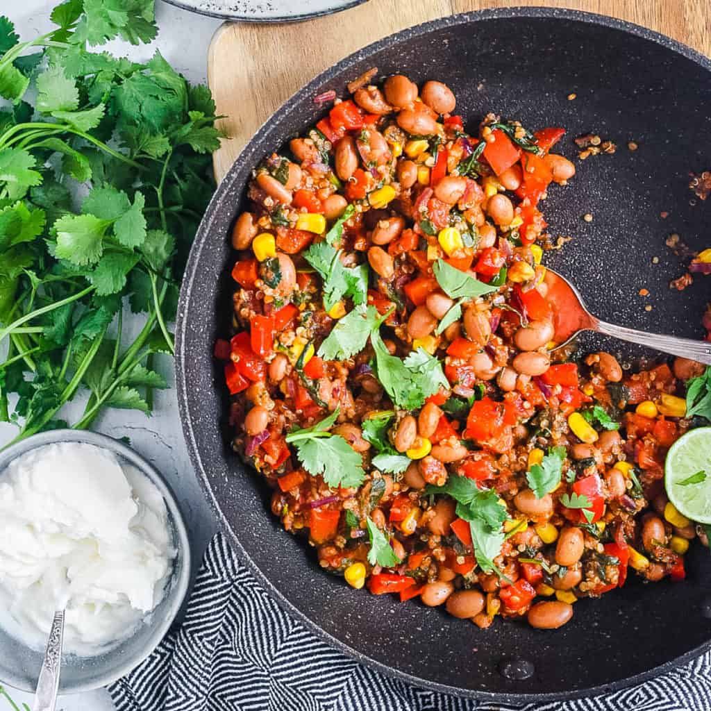 pinto bean casserole with veggies and quinoa in a pan