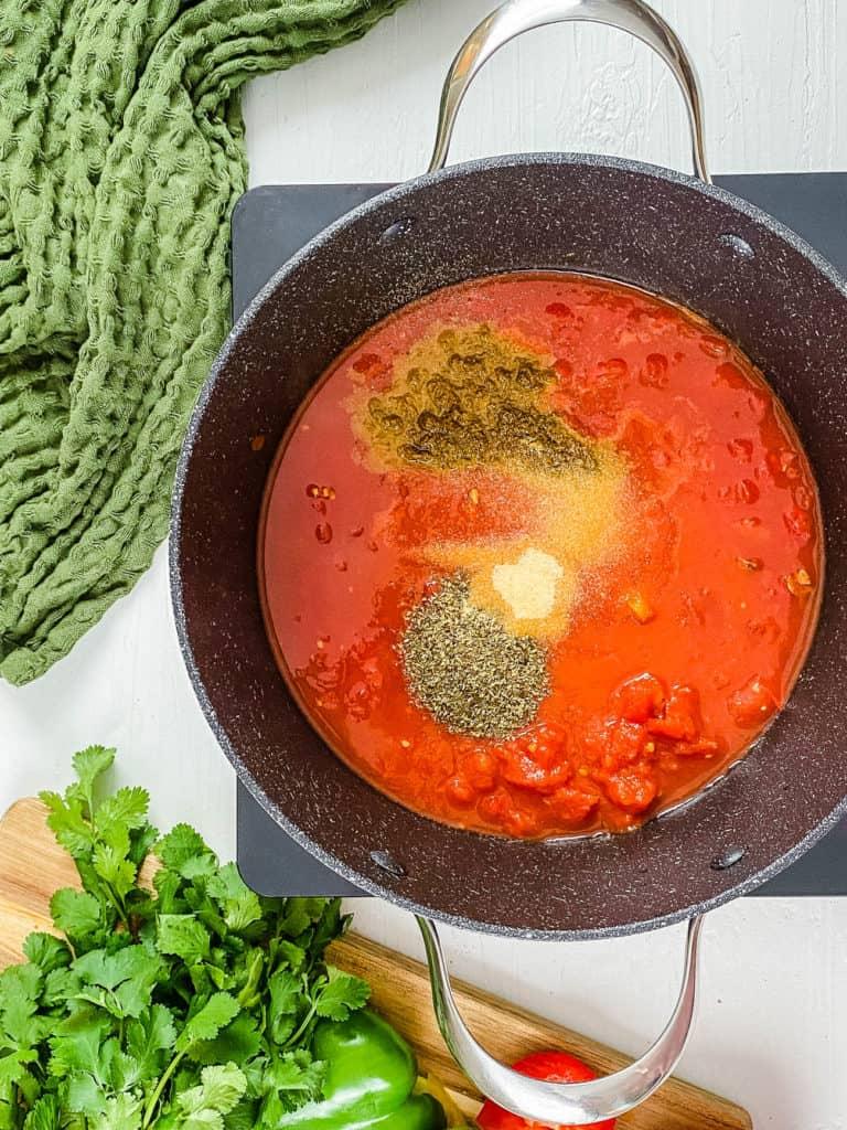 sauce for enchilada casserole in a pot