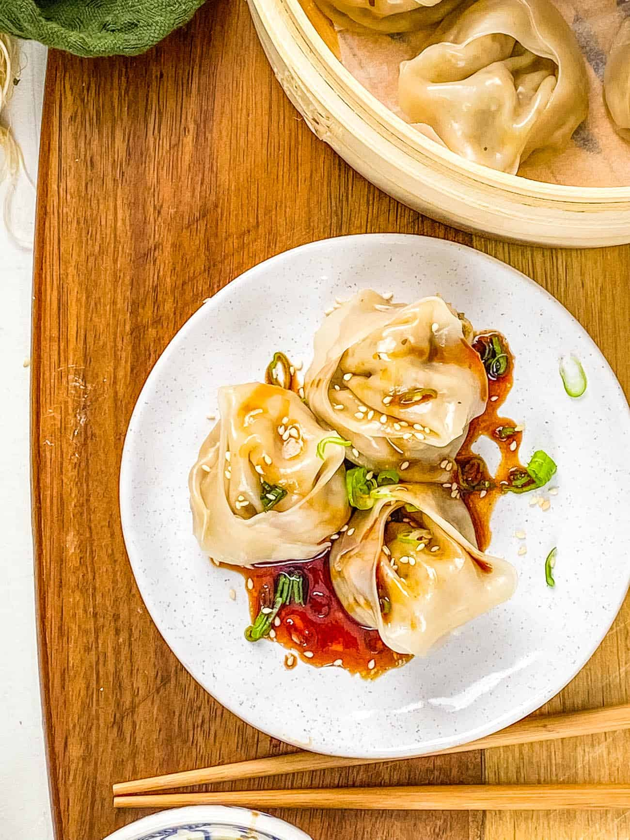 vegetarian wontons on a plate with dipping sauce