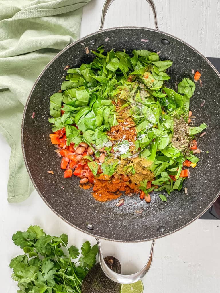 spinach and quinoa added to pan